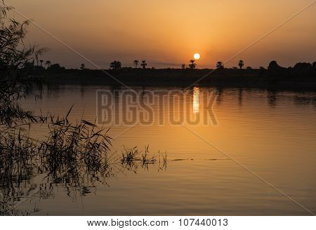 Sunset Over A River