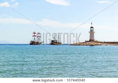 Lighthouse And Sail Ships In The Mediterranean Sea