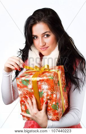 beautiful girl with a gift in a pink coat on a white background
