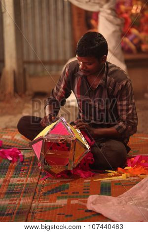 Pune, India - November 7, 2015: A Man Making A Traditional Sky Lantern In His Shop On The Occasion O