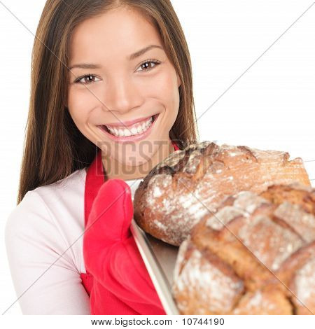 Woman Showing Fresh Baked Bread