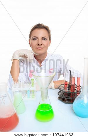 Woman chemist and chemicals in flasks, isolated on white