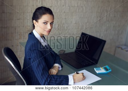 Accountant Calculating Taxes In Office