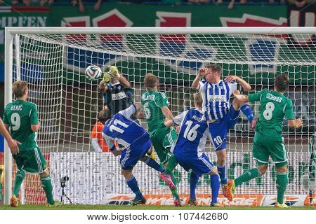 VIENNA, AUSTRIA - AUGUST 28, 2014: Mario Sonnleitner (#6 Rapid) tries to score a goal in an UEFA Europa League qualifying game.