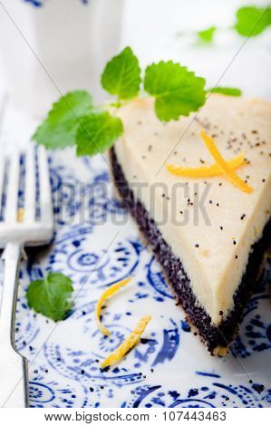Poppy seed cream tart, cake, pie slice with lemon zest