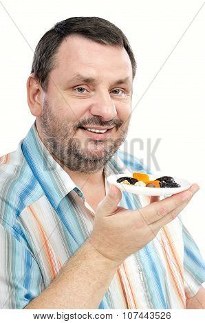 Cheerful man promoting dried fruits diet