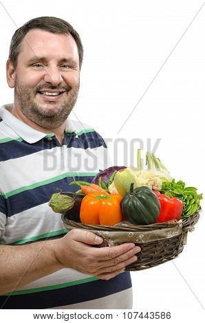 Cheerful vendor with a basket of vegetables