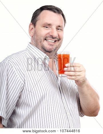 Smiling guy is fond of vegetable smoothie
