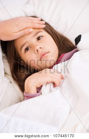 Little girl lying in bed