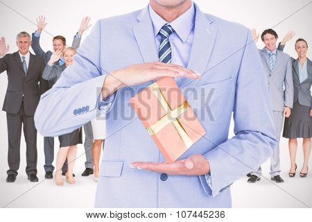 Handsome businessman gesturing with hands against present Handsome businessman gesturing with hands on a white background