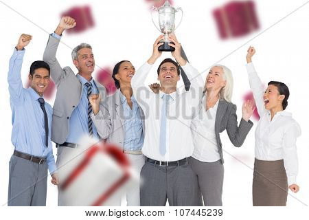 Business people holding cup and cheering against white and red gift box