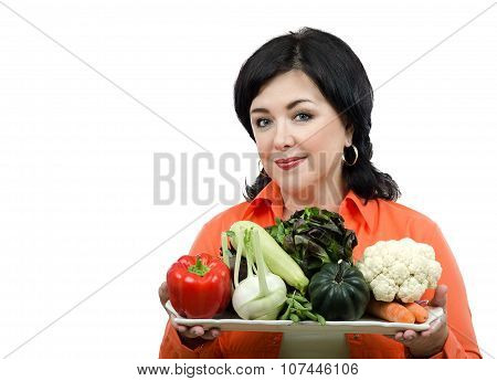 Nutrition consultant with a tray of fresh vegetables