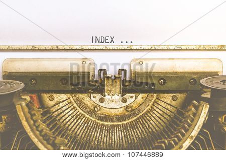 Typewriter And Empty White Paper With A Word Index, Vintage Style