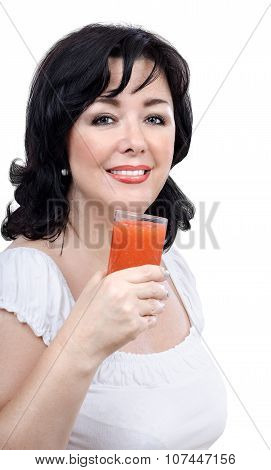 Smiling woman with glass of homemade smoothie