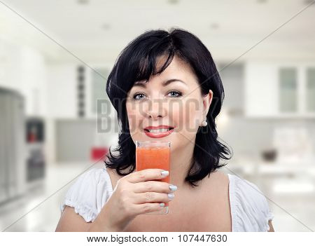 Woman is up to drinking detox smoothie