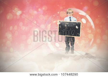 Festive child in snow globe against red abstract light spot design