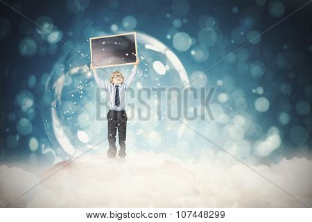 Festive child in snow globe against blue abstract light spot design