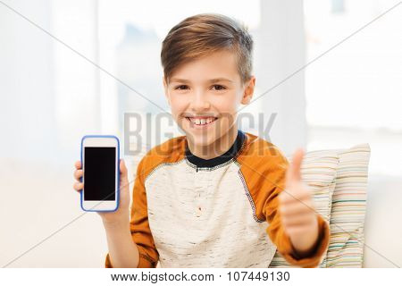 leisure, children, technology, advertisement and people concept - smiling boy with smartphone at home
