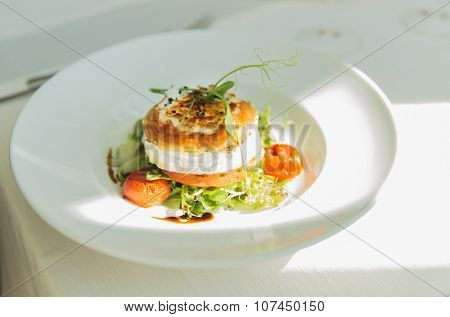 food, culinary, haute cuisine and cooking concept - close up of halloumi cheese salad with vegetables on plate at restaurant