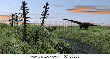 mamenchisaurus on grassy terrain above a river