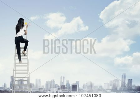 Business Woman Standing On The Ladder High And Shout With Megaphone