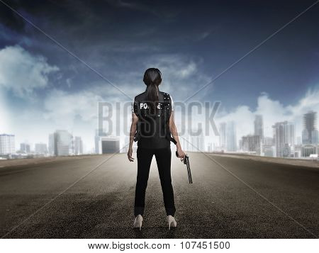 Police Woman Standing On The Empty Street