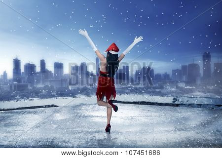 Asian Woman Wearing Santa Claus Costume, Standing On The Rooftop