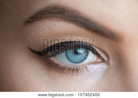 Closeup image of beautiful woman eye with fashion makeup with eyeliner