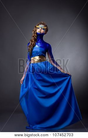 Sensual  Woman In Blue Glitter Dress, Rhinestones On Face, Standing, Grey Background