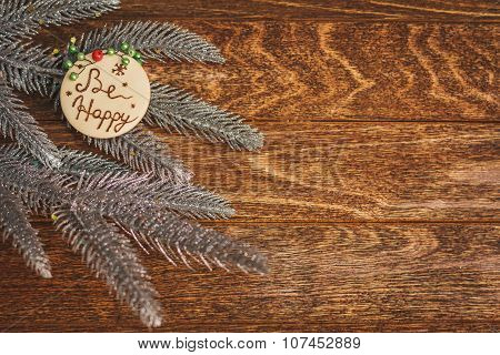 Christmas Tree With Burned Inscription Be Happy On Wood Texture