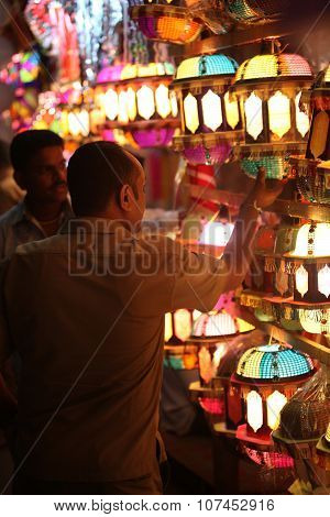 Pune, India - November 7, 2015: A Streetside Shopkeeper Showing Sky Lanterns To A Customer On The Oc