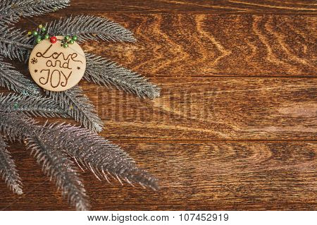 Christmas Tree With Burned Inscription Love And Joy On Wood Texture