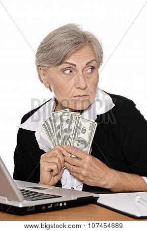 Elderly woman with dollars