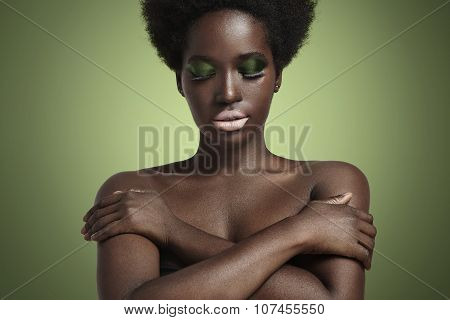 Black Woman With False Lashes And Metallic Eyeshadows