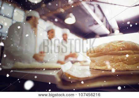 Snow against fresh bread with bakers behind him