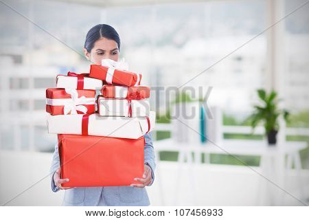 Fired businesswoman holding box of belongings against office