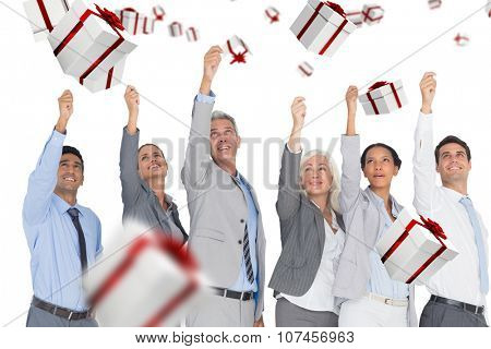 Smiling business people raising hands against white and red gift box