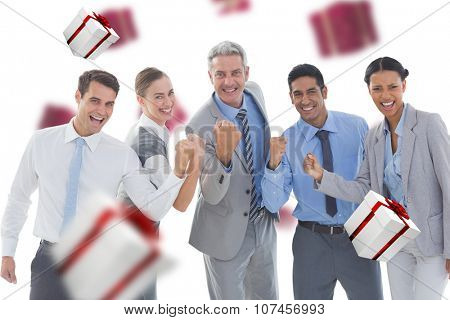 Portrait of successful business people clenching fists against white and red gift box