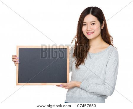 Young Woman showing with chalkboard