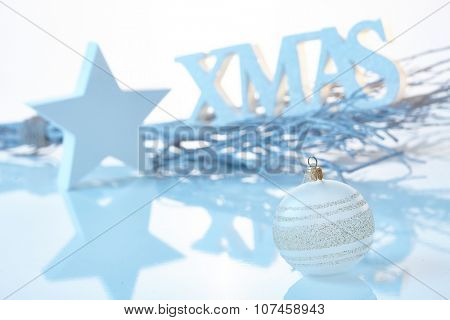 Pure white christmas decoration with ornaments and letters xmas.