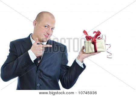 Businessman Offering A Gift Isolated On White Background