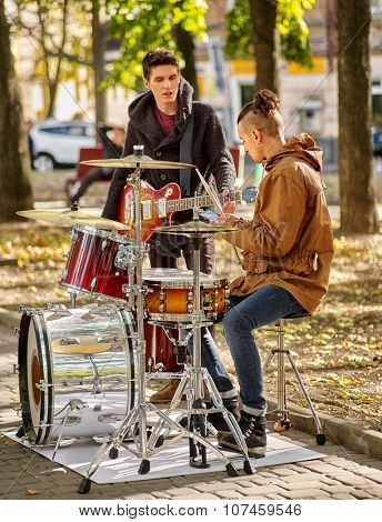 Two Music street men performers on autumn outdoor.