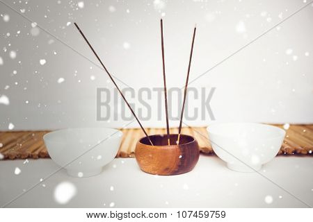 Snow against incense burning and perfumed candles