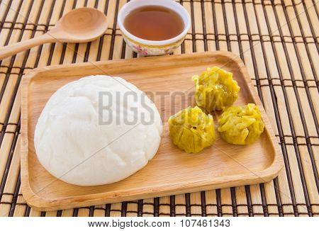 Buns And Dumpling In Wooden Plate