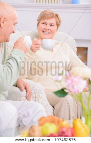 Loving couple drinking tea