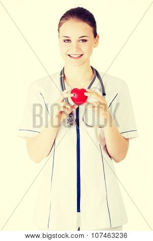 Young nurse with heart in her hand.