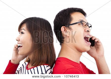 Young asian couple talking on the phone