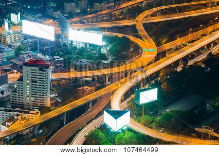 Elevated expressway and cityscape at night