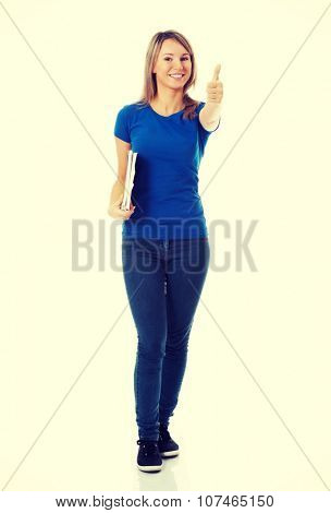 Young beautiful student woman showing OK, holding workbook.