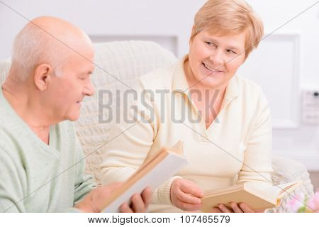 Adult couple reading book